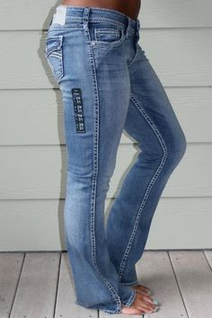 """Low Rise, Slightly Curvy Fit, Relaxed Hip and Thigh, Bootcut Leg, 31"""" Length 98% Cotton 2% Spandex Our model is 5'6"""" and is wearing a size 29."""