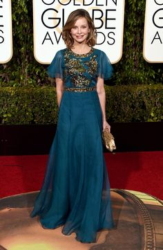 Calista Flockhart The Supergirl actress wore a teal Andrew Gn dress with ruffled sleeves and floral beading.