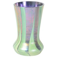 This Gorgeous Art Deco vase by Tiffany & Co. is made of superior quality glass in iridescent violet and a reed design. This piece is signed.