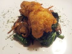 A late night appetizer... Enjoy ;)    Fried Catfish on a Bed of Sauteed Spinach, Carrots and Baby Portabella Mushrooms.