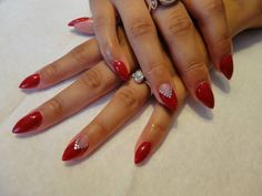 Beautiful red stiletto nails with silver rhinestone accents. Acrylic nails. Nails by Holly Folka