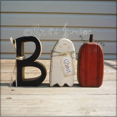 """This listing is for the word Boo with a pumpkin jack o lantern and ghost as the o's. It is made from 2"""" pine they stand about 7"""" tall and 10"""" long. The B has been smothered in black sparkly glitter. The ghost and the pumpkin have been sanded, stained and painted to give them a primitive look"""