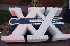 The French Laundry's 20th Anniversary Party: Thomas Keller's French Laundry feted its 20th anniversary with an event in July at its famed Napa Valley home. The celebration included a cake with the roman numeral XX, for 20, speared by the restaurant's clothespin logo.