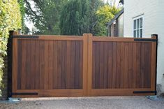 Bespoke Henley automated wooden gates installed in Oxfordshire with oiled finish