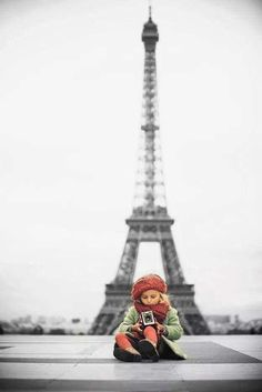 cute girl in front of Eiffel tower