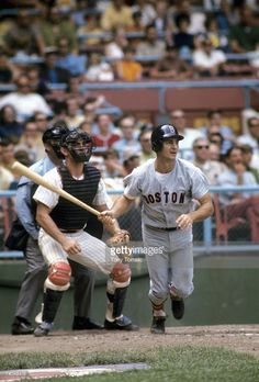 Outfielder Carl Yastrzemski #8 of the Boston Red Sox watches the ball he's just hit during a game in July, 1970 against the Cleveland Indians at Municipal Stadium in Cleveland, Ohio. The Indians catcher is Ray Fosse.