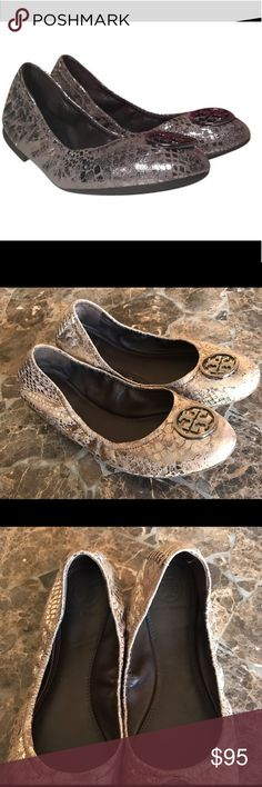 Tory Burch unique Heidi ballet flats size 7.5 new! Tory Burch limited edition metallic snakeskin Heidi ballet flats in size 7.5. Please ignore the description photo that says size 6. They are a size 7.5!! The only flaw is one of the double T silver logos is loose on one shoe on one side. It is not noticeable, nor does it move around when wearing. Other than that they are brand new, never worn, and in beautiful pristine condition! If it should bother you any Tory Burch store will fix for…