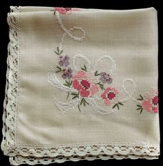 Vintage tablecloth with cross stitch embroidered flowers