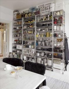 I do like the industrial feel that IKEA's shelves provide. I'd like to experiment with a shelf like that in the hallway that can stack shoes and magazines and all that... (originally found via http://hemmariket.se/)