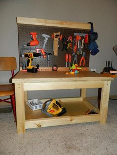 Now thats what I'm talking about. No play kitchens in this house. Play Workbench | Do It Yourself Home Projects from Ana White