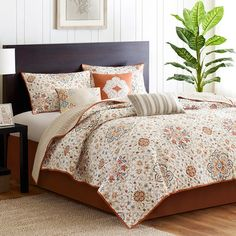 Bring a calming ambiance to your master suite with this quilted coverlet set, featuring a floral motif in earth-toned neutrals.    Produ...