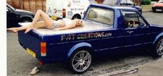 Girls posing with a blue Volkswagen Caddy Pickup #Babe #VW #Lady #Model #Truck #Pick-up #Ute