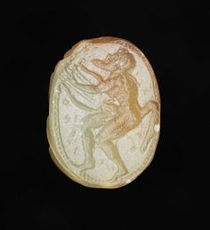 Scarab with a satyr tuning his lyre. Greek, Archaic Period, 525–500 B.C. Intaglio. Pierced for stringing (horizontal). Motif oriented vertically. Satyr rests lyre on his right thigh and holds it in place with right hand, while tuning pegs with left hand. Head is thrown back. Signed in Greek: Onesimos. Hatched border. Beetle: Ridged back. Single line dividing thorax and elytra.