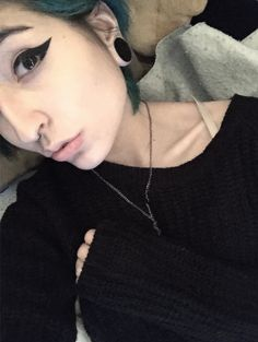 That eyeliner and her collarbones are beautiful