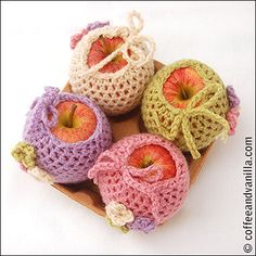 apple cozies with flower motifs