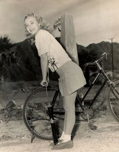 Jane Powell pumps a bike tire.