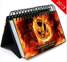 The Hunger Games 2013 Easel Desk Calendar: This Hunger Games 12 Month Desk Calendar runs for the year of 2013 and features images from The Hunger Hunger Games Trailer, Hunger Games Movies, Hunger Games Fandom, Hunger Games Catching Fire, Christmas Gift List, Holiday Gift Guide, Hunger Games Merchandise, Desk Calendars, Geek Girls