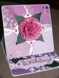 Floral easel card.  Sparkle organza, embossed cardstock, patterned paper, die cut leaves, wire lettering and a handmade paper flower.