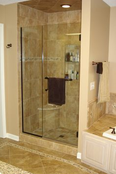 fiberglass shower door frame in brushed nickel consistent use of finishes on bathroom fixtures from towel hooks to door handles helps tie the rooms