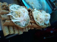 Tacos dorados de mercado....y enciima un par de sopes de salsa verde y queso Oaxaca deshebrado.