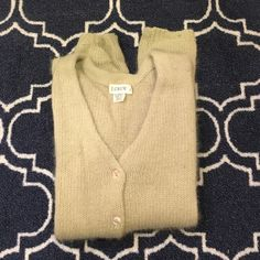 J.Crew lambswool and angora cardigan Green lambswool and angora sweater from J.Crew. Super soft. Lovingly worn. Some pilling and a small hole on sleeve (pictured). Price reflects condition. J. Crew Sweaters Cardigans