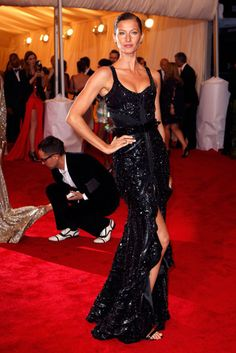 Could she be more beautiful? And the dress is stunning!
