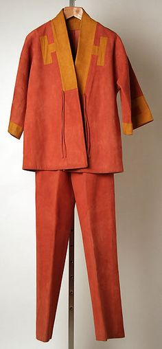 The Leisure suit: Designer: Bonnie Cashin (American, Oakland, California 1908–2000 New York) Date: spring/summer 1975 The suit was popular for men & women for the day and it was made with wide lapels.