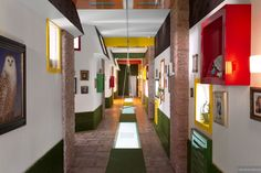fun hallway in primary colors with swing and brick borders