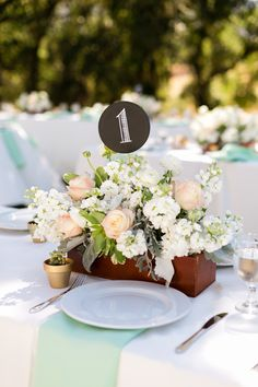 The roses in a box give it a pretty garden feel! View the full wedding here: http://thedailywedding.com/2015/12/07/golden-oaks-ranch-wedding-kayla-brian/