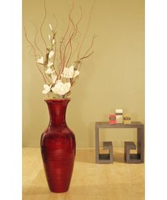 accent your home decor with this bamboo floor vase and white magnolias gorgeous floor vase