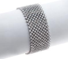 Gordon James Signature Large Ribbon Bracelet; 52.08 carats total weight in Round Brilliant Cut Diamonds. Set in 18k white gold.  http://www.gordonjamesdiamonds.com/products/diamond-bracelets/b-2068