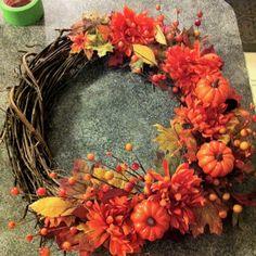 Wreath: Michaels craft store $4.00, Flowers,leaves & pumpkins: Dollar store: $6.00. FALL WREATH 