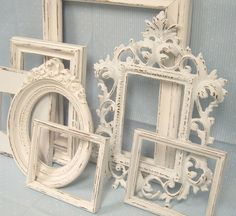 I intend to find various ugly frames at garage sales and thrift stores, and then spray painting them in a high gloss white paint....yes affordable and georgeous...