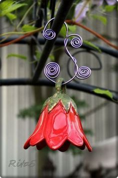 Turn a pinch pot into a pretty pinch flower/bell, would also look nice on a wind chime -RR