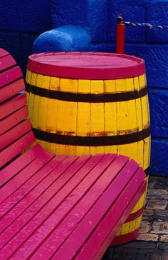 'Colourful chair and barrel at Boatyard Resort, Carlyle Beach.' von Lonely Planet Images bei artflakes.com als Poster oder Kunstdruck $18.44