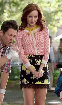 Cassandra's black and yellow floral skirt and coral printed cardigan on The Librarians