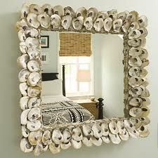Calm framed mirror. Perfect do it yourself project. I think I would try framing it with beach rope then randomly adding shells. Either way looks great.