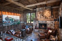 Modern-rustic barn structure offers an incredible retreat in Utah Mountains #familyroom #den #fireplace #rustic #barn #house
