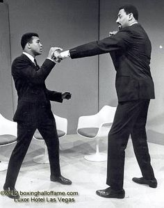"Cassius Clay AKA Muhammad Ali squaring off against Wilt ""The Stilt"" Chamberlain. The two men were going to fight at the Astrodome back in 1967. Posters were made for the fight. I think Chamberlain had the reach advantage. Ali had the chin. Ali looks a bit intimidated in there. Wilt looks like he's smiling.  Boxing Hall of Fame - Google+  boxinghalloffame.com"
