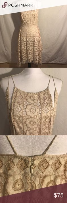 Free People Boho Lace Dress, Size 12 This dress is brand new with tags. It is 72% nylon and 28% cotton.  The lining is 100% rayon. The spaghetti straps are unique and very slender.  Pit to pit is 15 1/2 Inches Waist is 15 Inches Length is 33 1/2 from top of neckline. Free People Dresses Asymmetrical