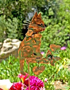 Cat metal yard art copper garden plant stake by Garden Copper Art is a one of a kind original handcrafted design. The precious kitty indoor or outdoor stake is sitting on a pedestal that is decorated with artistically melted free flowing solder applied. Other accents include a cute bow, a butterfly with a heart above, and a hanging heart placed under the pedestal. This item is now available for purchase. MEASUREMENTS: Please read measurements, thank you! ♥ Garden plant stake measures…