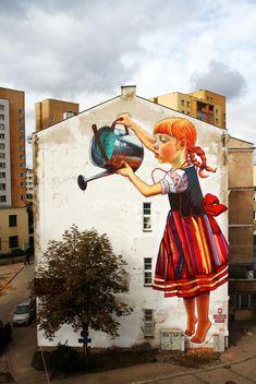 Young girl watering a tree by Natalia Rak l #mural #streetart
