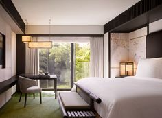 Guestroom with a bamboo garden view at the Four Seasons Kyoto by HBA Design.