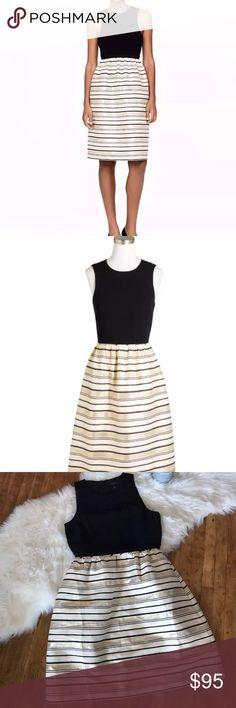 """Women's J.Crew Black Metallic Gold Dress J.crew Black and Metallic gold dress with hidden pockets, scoop neckline, sleeveless top, black top, gold and black striped flared skirt, and back zip closure with hook and eye clasp. Fully lined. Nice heavy material holds its shape. Cotton, silk blend construction with other fibers. In great condition!! Worn a couple of times.   Measurements: ( approximately )  Armpit to armpit: 19"""" Waits laying flat: 15"""" Shoulder seam to bottom hem: 39.5""""  Please…"""