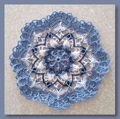 "I felt like naming this doily ""surprise by design"" because what you see now is as far as I've gotten for part 1 of this CAL. Sometimes surprises are so much fun and who knows where this mandala doily will end (or where!)... but that's half the fun isn't it! Come join me while we crochet together for"