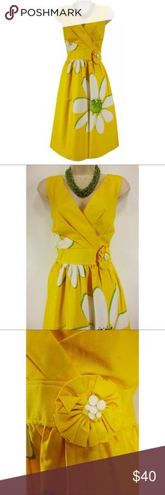 """Size 12 M/L PLEATED YELLOW FLOWER SUMMER DRESS This sexy, sweet, flower-print sundress is perfect for Summer! Size: 12 Back zip Lined bodice only Surplice neckline Attached Flower applique with beads at the left side of the waist Hidden side pockets Gorgeous, bold-floral print Slightly stretchy, super comfortable fabric Measurements: Bust (armpit to armpit):  38"""" Waist: 33"""" Hips:  50""""  Length: 39"""" (top of shoulder to bottom hem)  Condition:  PRISTINE CONDITION! Fabric Content: 97% Cotton  3%…"""