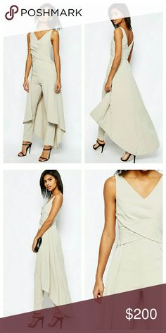 SOLD ASOS Skirted Back Jumpsuit NWTs. See comments. UK size 4 / US size 0. Completely sold out. Material has stretch and can fit a petite or slim 2-4. ASOS Pants Jumpsuits & Rompers