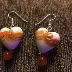 Check out this item in my Etsy shop https://www.etsy.com/listing/218359036/orange-swirl-dangle-earrings