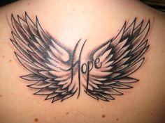 flügel tattoo am rücken