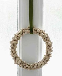 Spotted recently on Oslo-born stylist Paul Lowe's site, Sweet Paul: a DIY wreath of wooden beads with a simple, minimalist appeal. For step-by-step instructions, go to Sweet Paul.